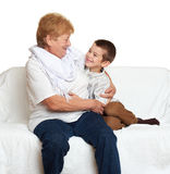 Child boy and grandmother on white, happy family concept Stock Photos
