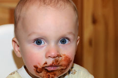 Child boy grimy chocolate Stock Images