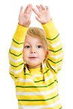 Child boy with hands up isolated on white Stock Image