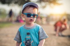 Kid boy beach portrait with sunglasses royalty free stock photo