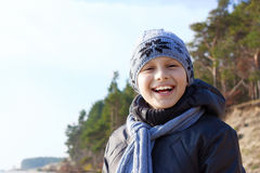 Child boy happy smile hat scarf. Outdoor Stock Photo