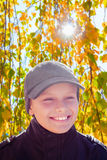 Child boy happy smile sun shine autumn leaves Stock Photos