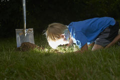 Child boy have unearthed a treasure in the grass Stock Photos