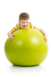 Child having fun with gymnastic ball Royalty Free Stock Photography