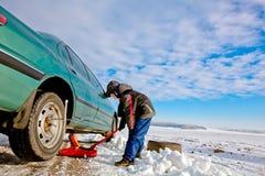 Child boy helps repairing car Royalty Free Stock Photo