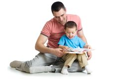 Child boy and his dad read a book. Isolated on white royalty free stock photos