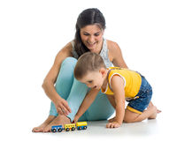 Child boy and his mother play with toy Stock Image