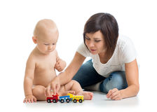 Child boy and his mother play with toy Stock Images