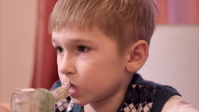 Child boy with inhaler. In home stock video footage
