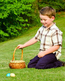 Child Boy kid collecting colorful Easter Eggs Royalty Free Stock Images