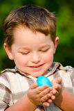 Child Boy kid collecting colorful Easter Eggs Royalty Free Stock Photos