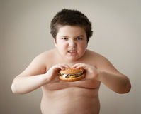 Child boy kid fat burger diet eating cheeseburger Royalty Free Stock Photo