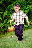 Child Boy kid running with Easter Basket Stock Images