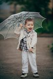 Child boy with lace umbrella Stock Photos