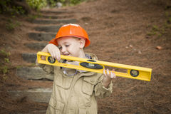 Child Boy with Level Playing Handyman Outside Royalty Free Stock Photos