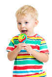 Child boy with lollipop isolated Stock Photography