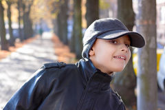 Child boy look out street trees fall. Season Royalty Free Stock Photos