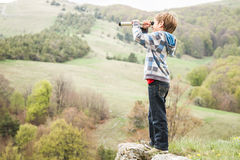 Child boy looking through binocular to the country side Royalty Free Stock Photo