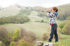 Child boy looking through binocular to the country side Stock Images