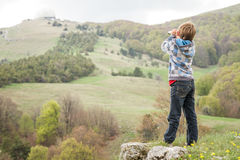 Child boy looking through binocular to the country side Royalty Free Stock Photography