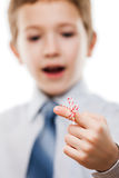 Child boy looking at finger tied string knot memory reminder Stock Photography
