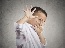 Child boy looking scared trying to protect himself. Closeup portrait child boy looking shocked scared trying to protect himself from unpleasant situation, object royalty free stock photo