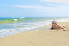 Child boy lying sand beach Royalty Free Stock Photo