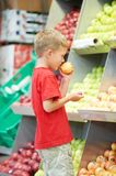 Child boy making fruits vegetable shopping Royalty Free Stock Photo