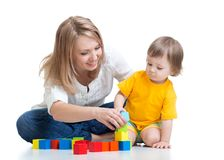 Child boy with mom playing wooden toys Royalty Free Stock Images