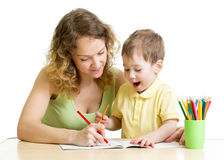 Child boy and mother draw with pencils Royalty Free Stock Image