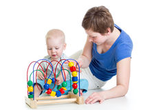 Child boy and mother play with color educational toy Stock Image