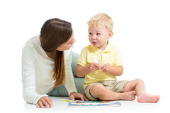 Child boy and mother play together with puzzle toy Stock Photo