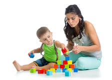 Child boy and mother playing together with block toys Stock Photos