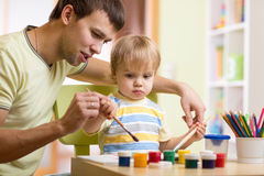 Child boy painting in nursery at home Stock Photography