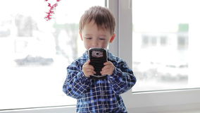 Child boy photographed with a smartphone. stock footage