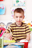 Child boy with picture and brush. Royalty Free Stock Photos
