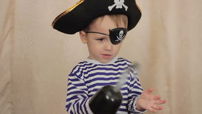 Child boy in a pirate costume. At home stock footage