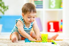 Child boy playing with block toys indoor Royalty Free Stock Photo