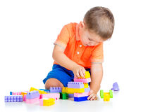 Child boy playing with construction set. Cheerful child boy with construction set over white background royalty free stock image