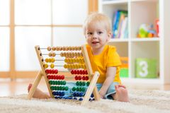 Child boy playing with counter Stock Photography