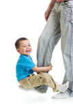 Child boy playing on father's foot Royalty Free Stock Photo
