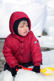 Child boy playing in the snow Royalty Free Stock Photo