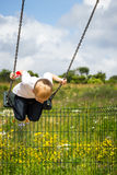 Child boy playing on swing outdoor. Stock Photos