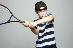 Child Boy Playing Tennis. Sport kids royalty free stock photos