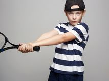 Child Boy Playing Tennis. Sport kids stock photo