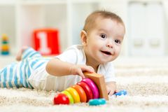 Child boy playing with toy at home Stock Photos