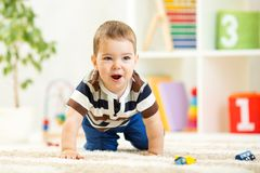Child boy playing with toys indoor Stock Images