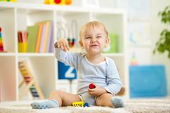Child boy playing with toys indoor Royalty Free Stock Image