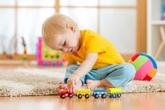 Child boy playing with toys indoor Royalty Free Stock Images