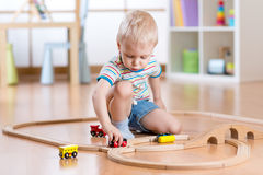 Child boy playing with toys indoors at home Royalty Free Stock Photos